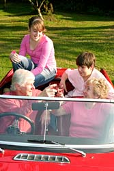grandparents and kids in car