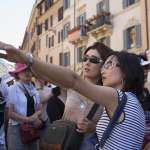 Observing Social Norms When Traveling